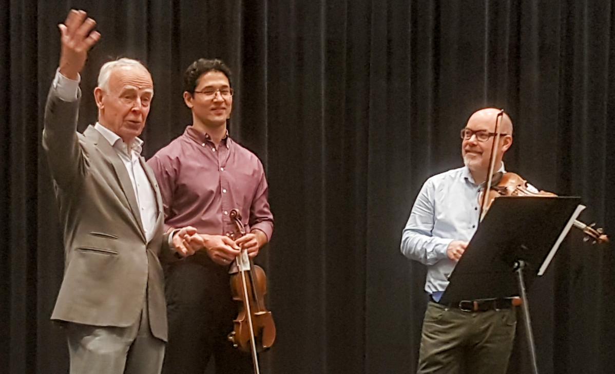 Erik Juhlin, Iskandar Komilov, violin I och Per Öman, stämledare violin II.